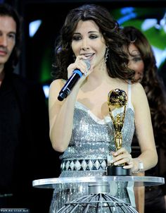 Nancy Ajram! Favorite female Arabic singer <3
