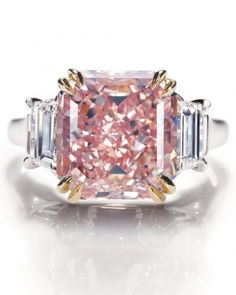 Extremely rare fancy-intense pink-diamond ring in a platinum setting from Harry Winston.                 The Pink Diamond appears to be a radiant cut and NOT an asscher as its home website says!
