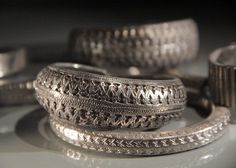 Viking Silver.Decorated silver arm rings from the Spillings Hoard, on display in Gotlands Museum.