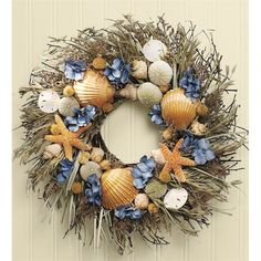 Woven with feathery caspia and stalky avena on a twig base, this bountiful seashell wreath is laden with a hand-selected collection of natural sea urchins, shells, sand dollars and starfish. With past More