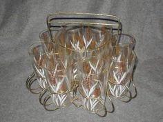 Golden wheat was a popular mid-century motif and in this case, so nicely off-set by the bright white leaves.  The ice bucket and glasses in their convenient caddy give dinner-party guests a festive way to self-serve water.