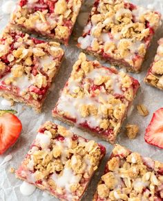 These are the easiest and best Strawberry Oatmeal Bars! Made in one bowl with a buttery crumb topping, sweet fresh strawberry filling, and vanilla glaze. Recipe uses 100% whole grains, so they are healthy enough for a snack but sweet enough for dessert! @wellplated