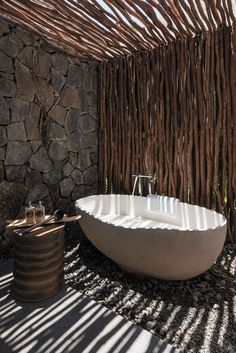 Outdoor standalone bathtub.