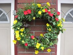 Living Wreath Impatiens - love this idea but don't think it would work in this climate. She mentions trying with succulents too, that might fare better.