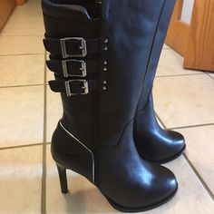 Women's Harley Davidson boots NWT black high heeled Harley Davidson Boots. Genuine leather upper. Super buckles. Extremely tough looking boots. Harley-Davidson Shoes Heeled Boots