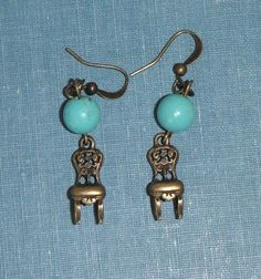 These darling earrings are tiny brass chairs (they may be thrones!) 1/2 inch long. The chairs hang below small turquoise rounds . The total drop of the earrings is 1 inch. They are hanging from antique brass french hooks. They would be a great gift for a queen or princess you know - or for the princess you know you are!