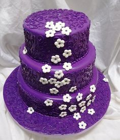 Purple wedding cake with white flowers