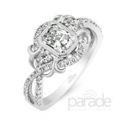 from Parade DesignParade's Award-Winning Lyria Platinum Design Is The Perfect Pairing Of Sleek Modernism With Vintage Romance. Satin Brushed Flourishes And Gracefully Intertwining Rows Of Diamonds Accentuate An Emerald-Cut Stone.