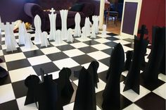 We can't possibly think of a better wedding game for a black-and-white wedding than chess. This DIY Giant Chess tutorial will teach you how to make huge chess pieces so your guests can play some life-sized chess during the reception.