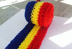 Available Here: https://www.etsy.com/listing/208546488/romania-flag-scarf-with-fringe-5-feet?ref=listing-shop-header-0 Romania Flag Scarf. Handmade Crochet with Fringe. Available on Etsy.