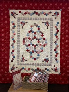 Hexagons are a hot topic at the moment. Nice use of them in this quilt. Also check out the free motion quilting.