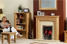 You won't find a better selection of wood and painted mantels and that's because in our factory next door we make fire surrounds for over 300 other fireplace shops all over the UK and abroad! Focus Fireplaces, Fire Surround, Stove Fireplace, Log Burner, Gas And Electric, Next Door, Mantels, Wood, Shops