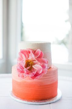 Colorful wedding cake idea - two-tier coral pink ombre frosted wedding cake with fresh, blooming hot pink peony {Ashley Cook Photography}