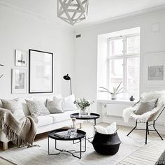 Bright modern Scandinavian living room with black and white details.