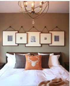 Layered frames in the bedroom. Classy and elegant. I like this look...
