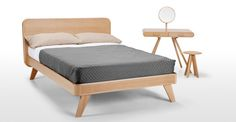 A double bed with an oak frame.