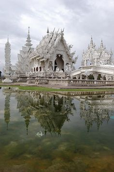 Reflections of Wat Rong Khun in Chiang Rai, Thailand (by owenelias).