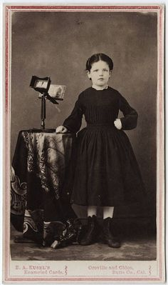 cdv of a young girl with a stereoscope by Kusel's Butte Co., CA