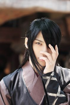 Behind-the-Scenes Pics of Jaejoong's Long-Haired Look in Codename: Jackal