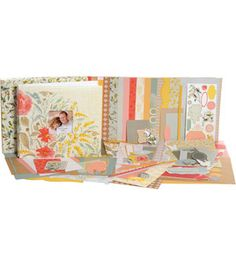 SEI-1 Hour Album Scrapbook Kit. Use this quick and easy scrapbook kit to complete any project in about an hour. It includes pre-cut pieces for twenty page layouts with room for thirty-seven photos; step-by-step instructions; die-cut accents; chipboard decorations; custom charms; adhesive pearls; satin string; a post-bound album; and a keepsake box to create the perfect 12x12 inch keepsake. Design: Lexington. Imported.