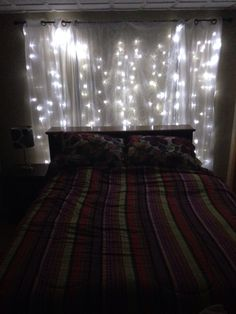 String lights behind sheer curtain headboard. Love this idea for wrapping lights around the ...