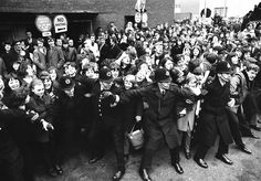 Policemen good-humoredly control screaming Beatles fans as the Liverpool pop group were welcomed by a group of more than 5,000 on their arri...