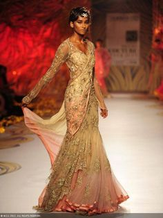 A model showcases a creation by designer Gaurav Gupta on Day 5 of Delhi Couture Week, held in New Delhi, on August 04, 2013.