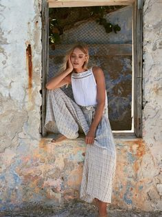 Sun Island Extreme Wide Leg | In a linen-cotton blend these striped pants feature an extreme wide leg. * Smocked elastic waistband with ruffle trim * Adjustable tie at the waist * Hip pockets * Semi-sheer
