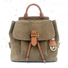 """NWT Michael Kors Romy Medium Backpack in Desert Suede  Cast in sumptuous suede with luxe contrast trim, this Michael Kors backpack blends sophisticated style with a sporty silhouette that lasts all day and into the night. * 13"""" W x 11-1/2"""" H x 3-1/2"""" D * Interior features 1 zip pocket, 2 utility pockets, 1 slip pocket and key clip * 14""""-16""""L adjustable backpack straps * Drawstring and push-lock closure * Exterior features 1 front slip pocket and hanging logo medallion * Gold-tone hardware…"""