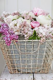 Lovely floral arrangement in a rustic wire basket