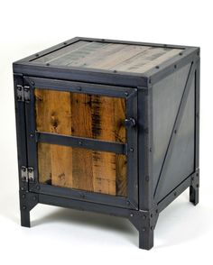 This Unique piece of industrial furniture is crafted from A mix of reclaimed oak and pine, hot rolled steel, expanded metal and custom gussets. All of the Fabrication and woodwork: Cutting, grinding, welding, drilling, riveting construction and finishing is done by hand, one part at a time. This custom made industrial cabinet would work great as a nightstand, end table or any other storage cabinet. It features a shelf about halfway up that runs throughout. The steel has a hand applied wax…