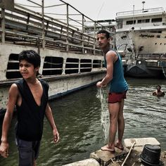 Young Egyptian fishermen work and swim along the Nile River in Cairo, Egypt, on May 27, 2015. Extreme hot weather with sandstorm hit Egypt on Wednesday, and the temperature reached 44 degree Celsius at noon. Photo by @Panchaoyue
