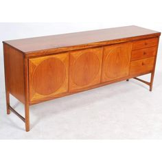 Beautiful Mid Century unit by Nathan with stunning teak surfaces. Incredible grain and patina. CLICK HERE FOR A VIDEO This fabulous Nathan Circles statement piece will make a truly stunning addition to any modern interior. Featuring stunning marquetry to the door fronts, a solid teak top with three good sized drawers. Furniture Showroom, Retro Furniture, Rustic Furniture, Antique Furniture, Mid Century Sideboard, Mid Century Furniture, Marquetry, Antique Shops, Modern Interior