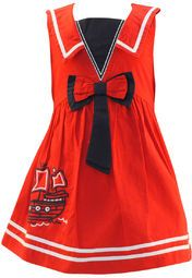 Red coloured dress for girls by Nauti Nati. Crafted from 100% cotton this knee length dress comes in a regular fit.