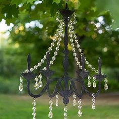 Get the glamorous look of crystal chandeliers without the grandiose cost! These lightweight chandelier silhouettes make an amazing ceremony accessory dangling from overhead branches or a sophisticated décor element for any reception venue. Valentines Day Weddings, Valentines Day Decorations, Bird Statues, Garden Statues, Light Decorations, Wedding Decorations, Rainbow Bubbles, Black Chandelier, Flower Chandelier