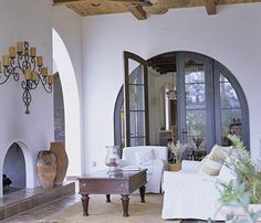 My Better Homes & Gardens Dream Home is Mediterranean- style complete with great arch doorways & fireplaces with lots of dark wood & tile floors.