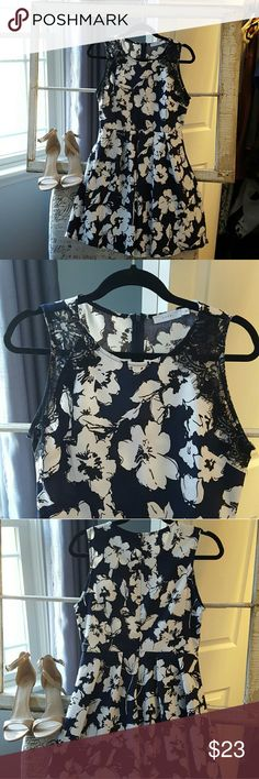 Navy, B&W floral dress Cute floral dress. It's fitted on top, but the bottom is flowy. The condition is like new, I only wore it once to a ceremony! I usually wear a small, so I think it could fit S or M. Lush Dresses