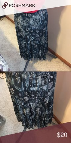 Blue print skirt by Christopher & banks This is a blue print skirt by Christopher & banks it's lined  it's inseam is 30 inches it's made of polyester and it a size xl Christopher & Banks Skirts Maxi