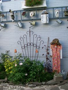 Paint an old ladder and mount it horizontally on the side of your house or shed for a wonderful garden accent that can hold birdhouses and watering cans.See more at http://ourfairfieldhomeandgarden.com/ or http://pinterest.com/barbrosen/