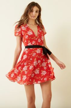 This flirty, feminine mini dress with retro sash is perfect for day to night summer soirees