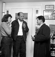 At Daniel Miller's general store in Springs, NY, Lee Krasner and Jackson Pollock talk with Tino Nivola, a new arrival at the artist colony
