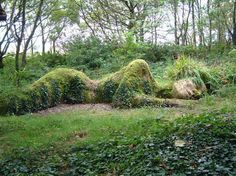 Giant natural sculpture of Gaia sleeping in the forrest.