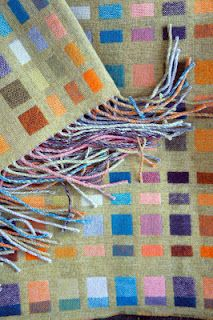 Holly Berry makes woven blankets, scarves, shawls, cushions and accessories using traditional artisan weaving practices
