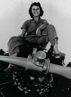 A PLANE JANE, not a plain Jane, was Jean Talcott Wicks, who flashed a winning smile for this 1943 U.S. Navy photo back when she served as an aviation machinist mate, 3rd class ~