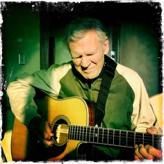Doc Watson in a pensive moment at MerleFest 2012 - photo © Scott Rouse