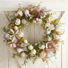 Pier 1 Imports Capiz Shimmer Egg Wreath ($80) ❤ liked on Polyvore featuring home, home decor, holiday decorations, handmade home decor, spring wreath, blue wreath, egg wreath and winter wreaths