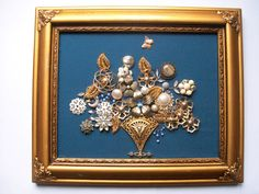 Rhapsody in Blue is an original collage/assemblage created by me using rescued and repurposed vintage jewelry. This collage contains beads and