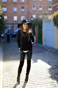 Shop this look on Lookastic: https://lookastic.com/women/looks/crew-neck-sweater-dress-shirt-leggings/14322 — Black Wool Hat — White Dress Shirt — Black Crew-neck Sweater — Black Leather Leggings — Black Suede Over The Knee Boots