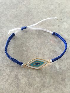 Βραχιολι με μοτίφ μάτι ρομβο κ κορδόνια στις αποχρώσεις του άσπρου κ του  μπλε f7769304b72