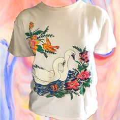 VINTAGE PSYCHEDELIC SWAN T-SHIRT •one of a kind t-shirt with extremely vibrant colors  •in great condition  •seems hand painted (I'm not sure though) {tags} Psychedelic hippie 60s sixties hand painted thrifted t shirt white orange purple pink blue green rare vintage retro urban outfitters cheap affordable trendy aesthetic unique fashion good quality summer 70s seventies vibrant bright colorful rainbow nature bird swan flowers flower graphic tee pride exotic one of a kind cute oversize...